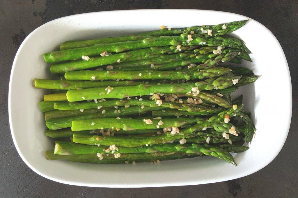 Home grown Asparagus fried in a stainless steal pan. With Kerry Gold butter and garlic.