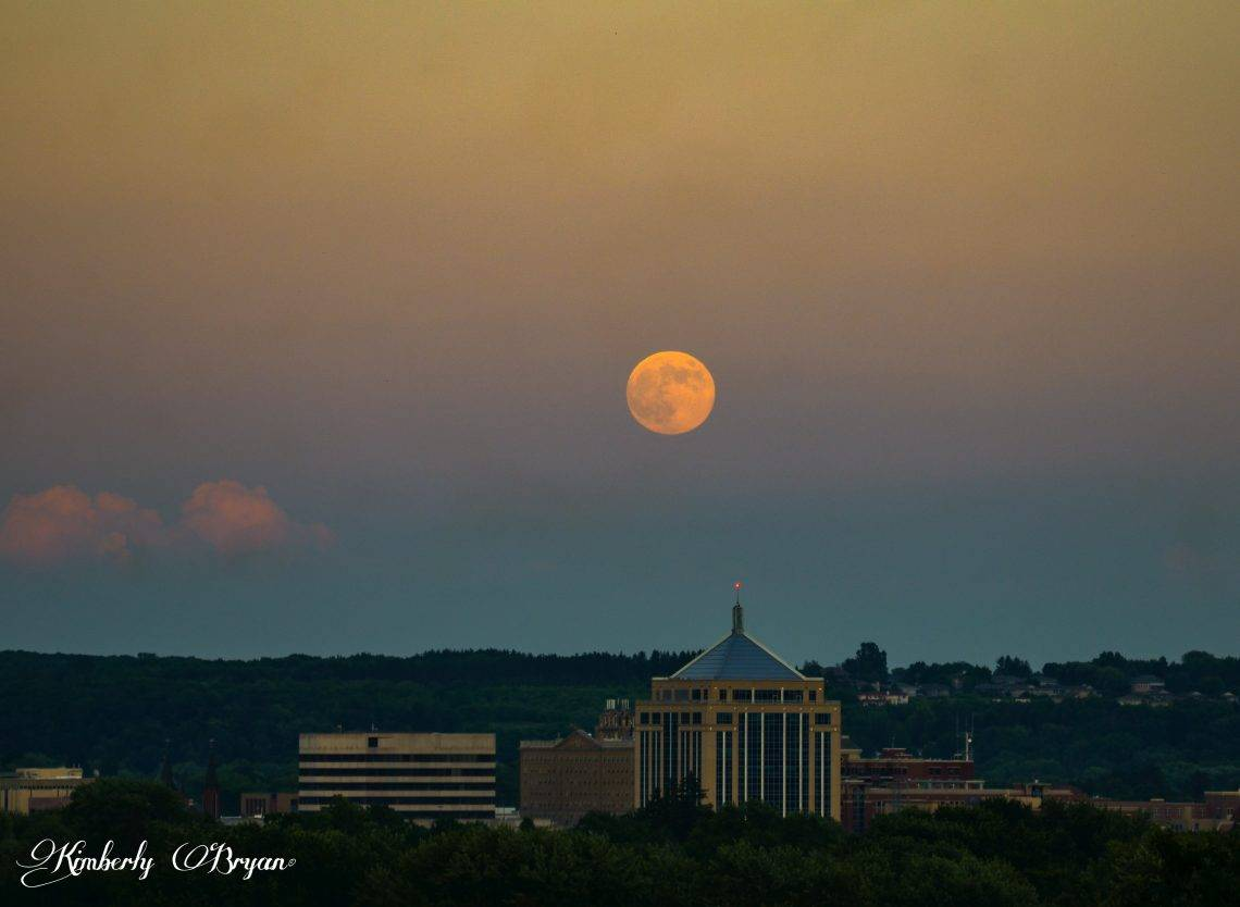 The June Full Strawberry Moon rising up over the city of Wausau