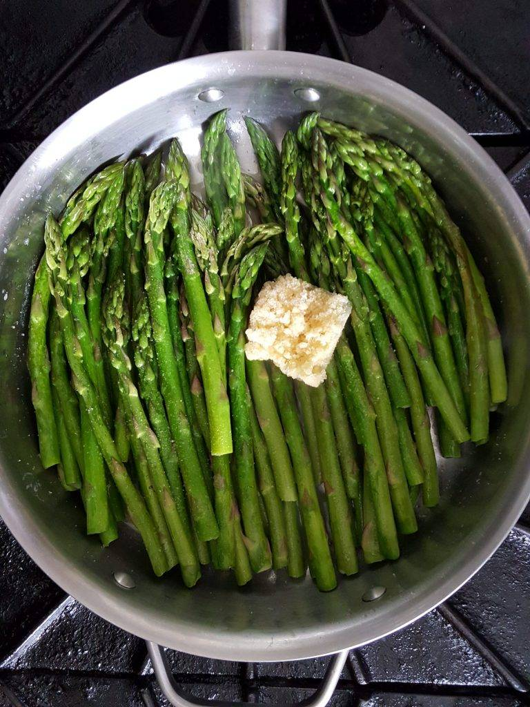 Mostly cooked asparagus with 2 Tablespoons of garlic.