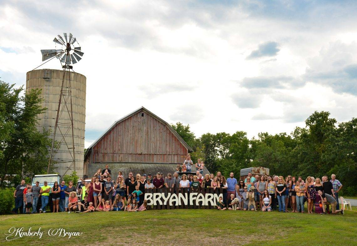 Family members standing in front of the Bryan 100 year old barn.