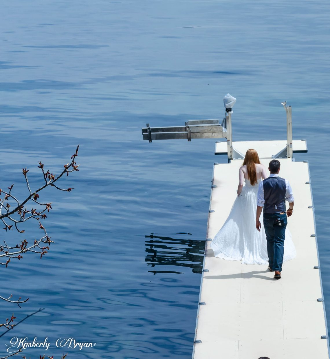 Bride and Groom walking on the dock.