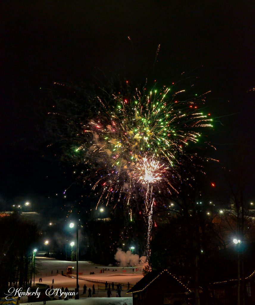 The night sky lit up by a large show of fireworks!