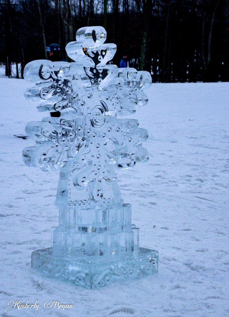 Looking at a large ice carved snowflake. Hand carved from a block of ice.