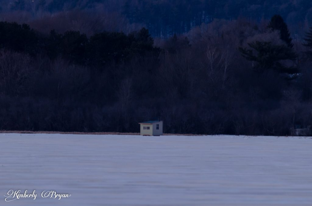 Looking out at one of the many Ice shakes on the frozen Wisconsin River.