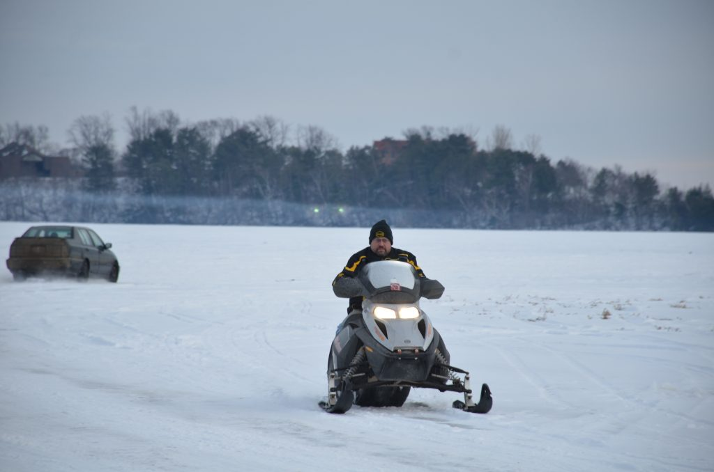 A person buzzing by on their snowmobile, looks like so much fun!