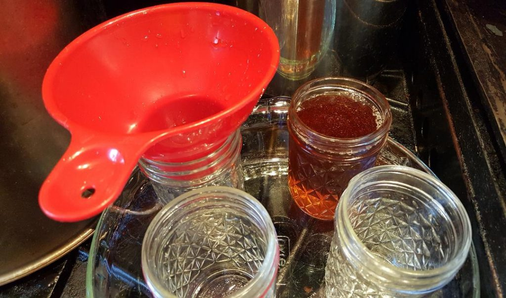 You are looking at canning jars being filled with fresh hot pure maple syrup.