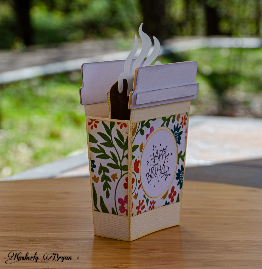 You are looking at the To Go Coffee Box Card from the side. I used a vanilla card stock for the base of the card. A floral band around the middle of the coffee card.