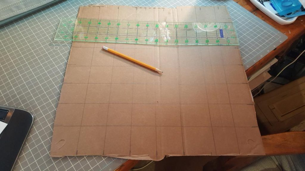 You are looking at a pizza cardboard box top being measured into 1 inch squares.