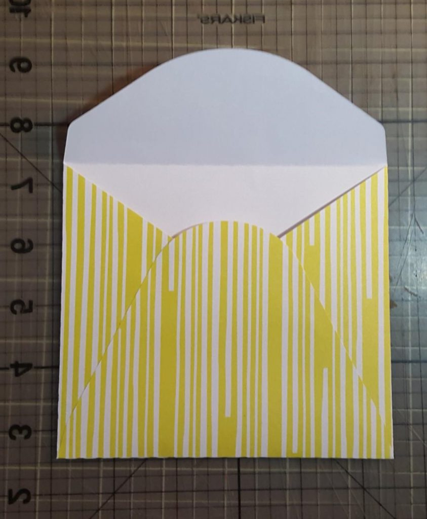 You are looking at the envelope that I cut out with my Silhouette Cameo. The svg file comes with the card.