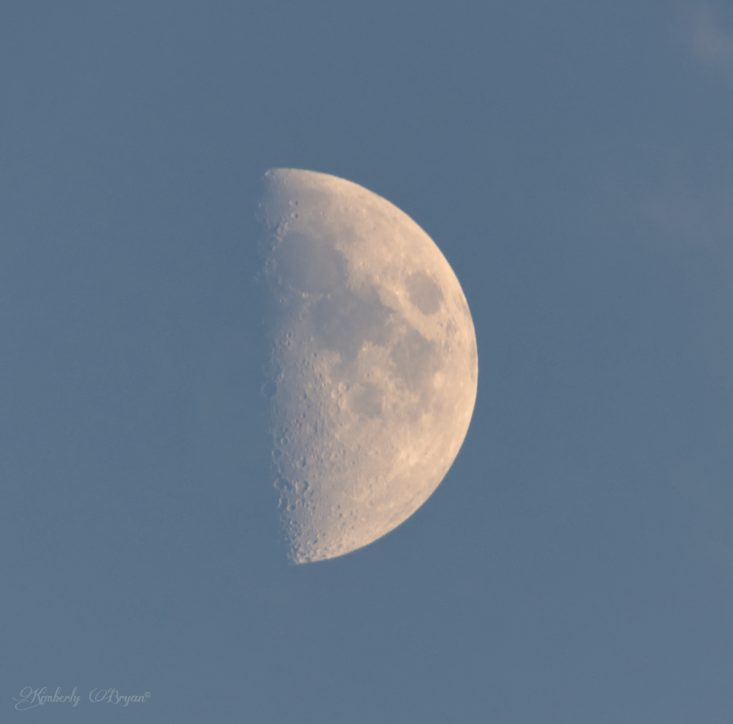 You are looking at the August Sturgeon Moon at 54.9% full, during the day. With a thin layer of clouds passing by.
