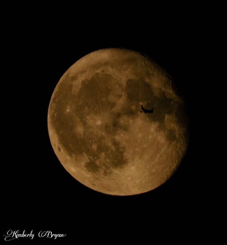 Trains, Planes and Automobiles post, a photo of a passenger jet flying over the front of the August Sturgeon Full Moon. I only had seconds to catch it. The moon was big, beautiful and bright orange.