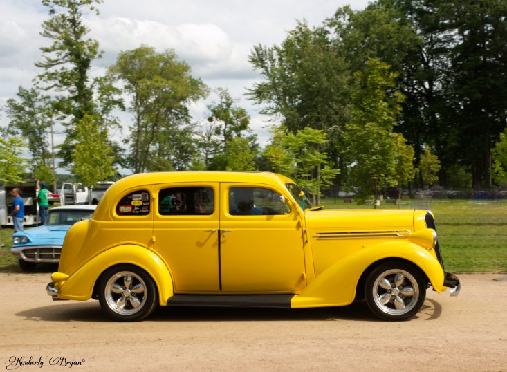 You are looking at a very bright yellow restored 4 door from maybe the 1940's. This car was one of my favorites, very classy looking. Mat have been a Limo.