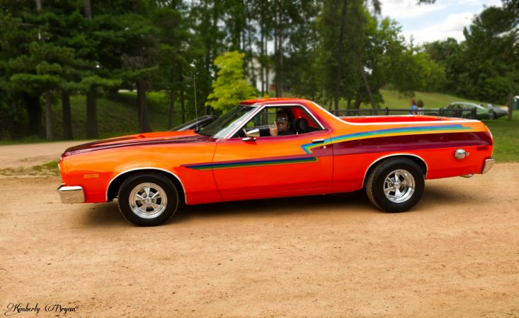 You are looking at a restored El Camino. Panted in bright oranges, blues and reds. From the Trains, Planes and Automobiles post.