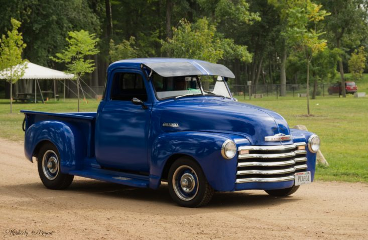 You are looking at an old vintage blue truck. It's a beautiful navy color with a large grill on the front, with lots of chrome. This is a photo from my blog post Trains, Planes and Automobiles.