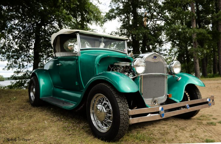 From my Trains, Planes and Automobile post.You are looking at a Roadster from 1929. It's body color is a beautiful metallic teal with lots of shiny chrome. I attended a car show last Sunday in Mosinee, Wisconsin. Vehicles from all eras were there.
