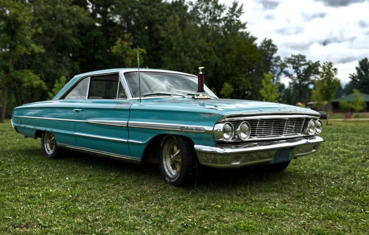 You are looking at a Ford car that had won a trophy. This car is teal in color with a white interior. This is from my blog post Trains, Planes and Automobiles.