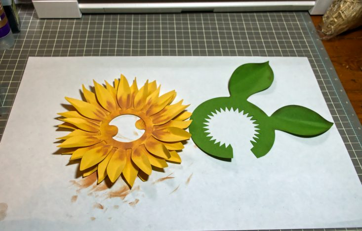 You are looking at a sunflower leaf cut out, inked around the edges for depth. I'll be gluing them to the bottom of the 3d layered sunflowers. This is from my Harvest Sunset Sunflower Wreath post.