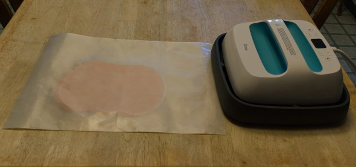 You are looking at me heat pressing HTV onto my wooden pumpkin sign. From