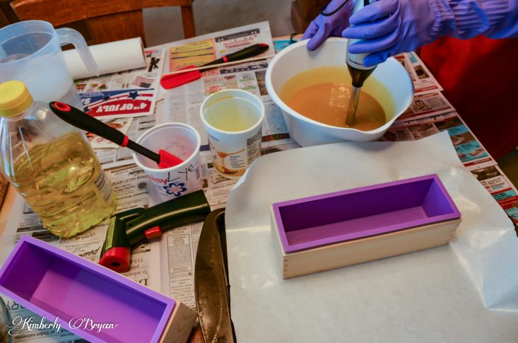 You are looking at me blending the lye solution into the goldenrod infused oils for my cold process soap. This is a post from Goldenrod Handcrafted Soap.
