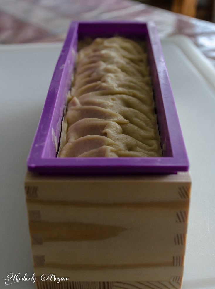 You are looking at the goldenrod soap cured after 24 hours. It's hardened and has lightened in color.