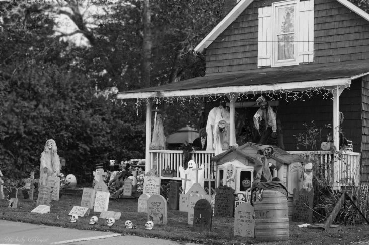 You are looking at a Halloween set up at an old spooky house. It's got skeletons with head stones and lots of skulls. Also several ghosts and pumpkins all around the yard. I took this in black and white for my post, Happy Halloween.