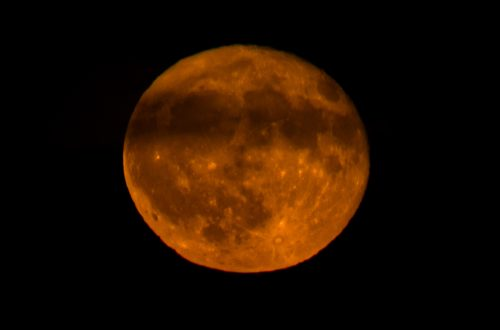 You are looking at the Hunter full moon. With a line if clouds going across the center. It created, what looks a face. I can clearly see the two eyes, nose and mouth. This is from my post, October Hunter Full Moon.