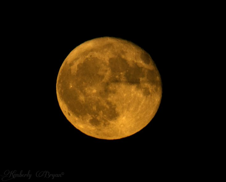 You are looking at the Hunter's Full Moon with a cloud going by it and an air plain just faintly showing up. This is from my post, October Hunter's Full Moon.