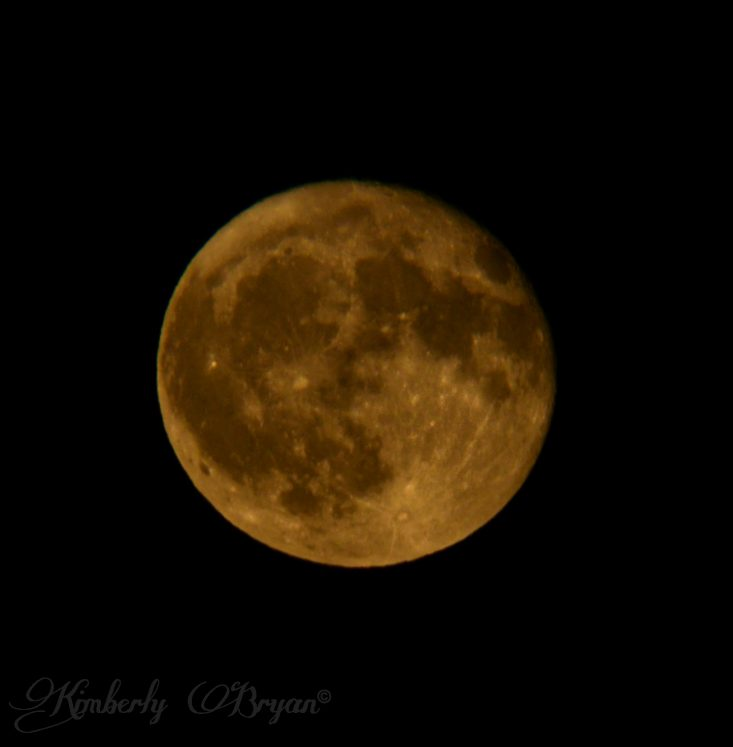 You are looking at the Hunter's Full Moon rising higher up into the night sky. He's loosing his bright orange color and turning more yellow now. This is from my post, October Hunter's Full Moon.