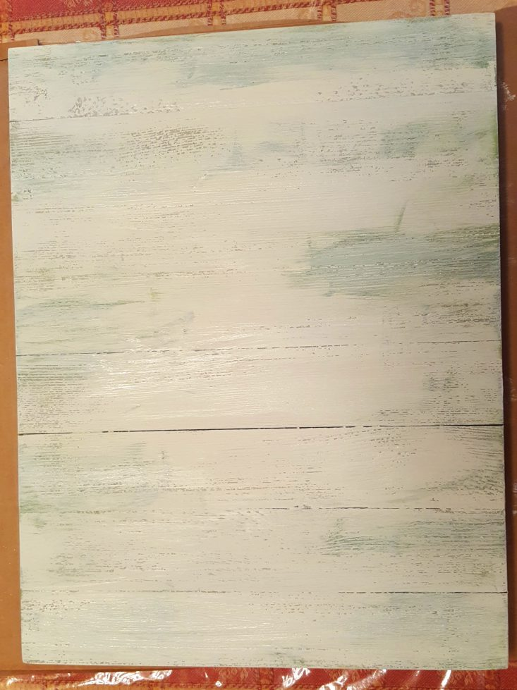 You are looking at the last layer of painting. I painted a layer of white chalk paint over the green layer. I'll let it dry thoroughly before sanding.