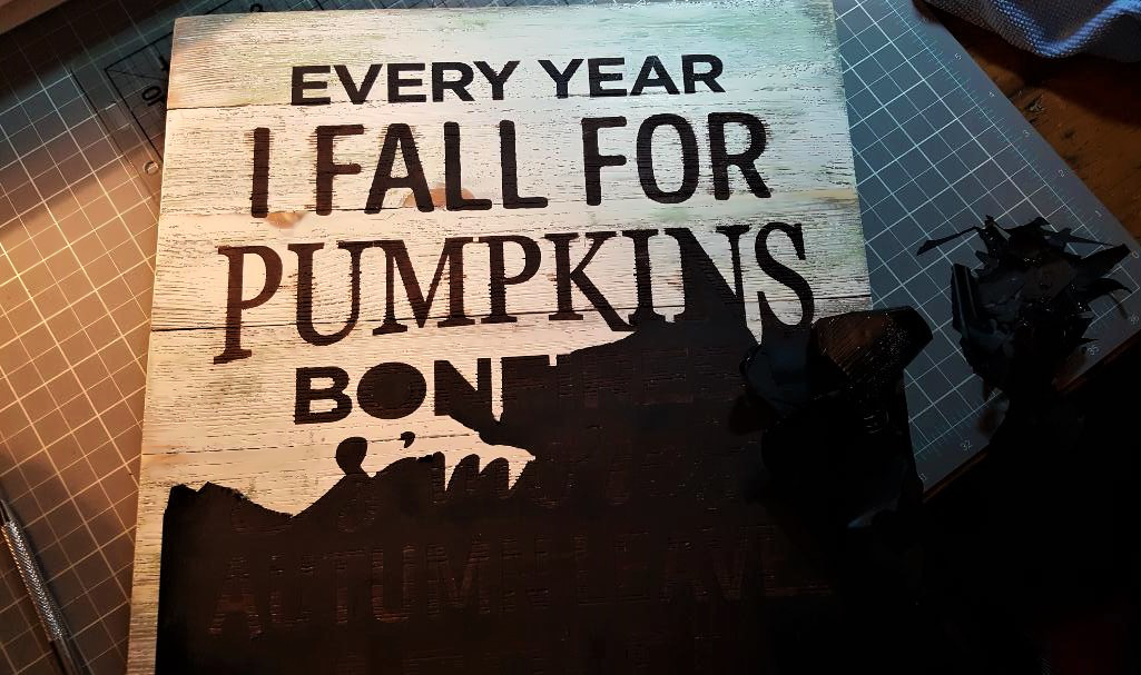 You are looking at me removing the vinyl stencil after I have painted my wood sign. I painted the letters in burnt umber. This is from my post, Every Year I Fall For Pumpkins sign.