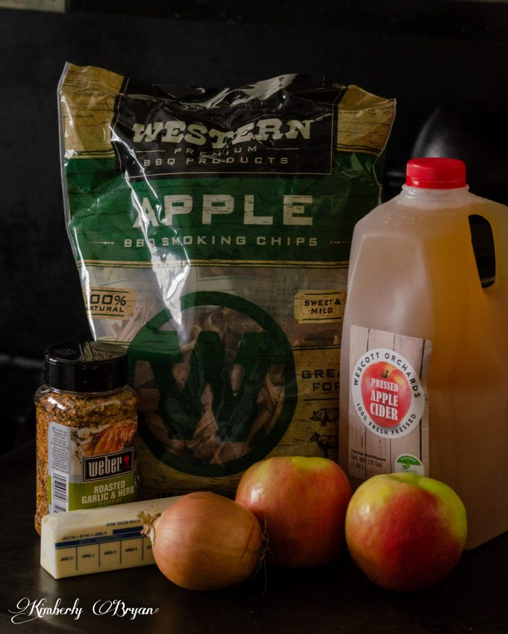 You are looking at a close up of the ingredients I used In Happy Smoked Turkey Day recipe. It's Apple Wood Chips, Apple Cider, Weber Garlic and Herb Seasoning, an Onion, Butter and two Apples.