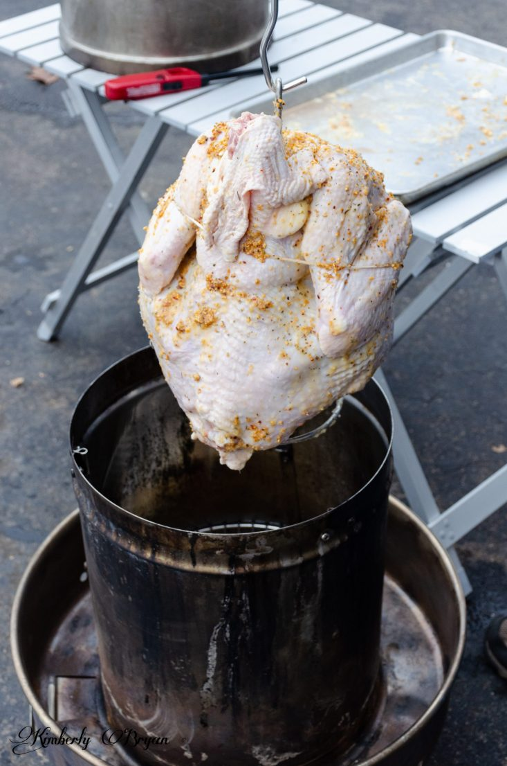 You are looking at the turkey being lowered into the Orion Smoker.