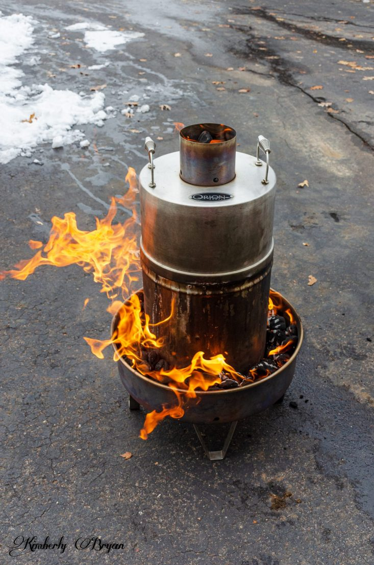 You are looking at the Orion with the lid on it and the charcoal being lit.