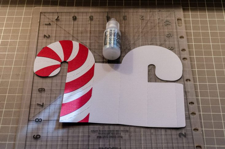 You are looking at the cut out card stock pieces that will form the 3D candy cane box card.