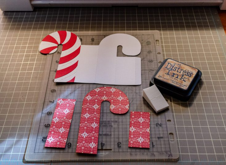 You are looking at all the pieces I cut out with my Silhouette Cameo. They will be put together to form the candy cane 3d box card.