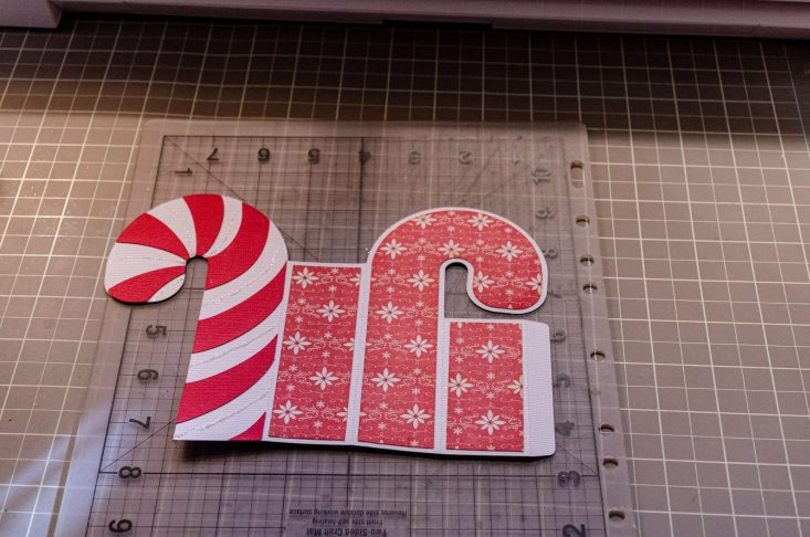 You are looking at the Candy Cane Christmas Card laying flat. I glued on the red candy strips and the decorative back panels.