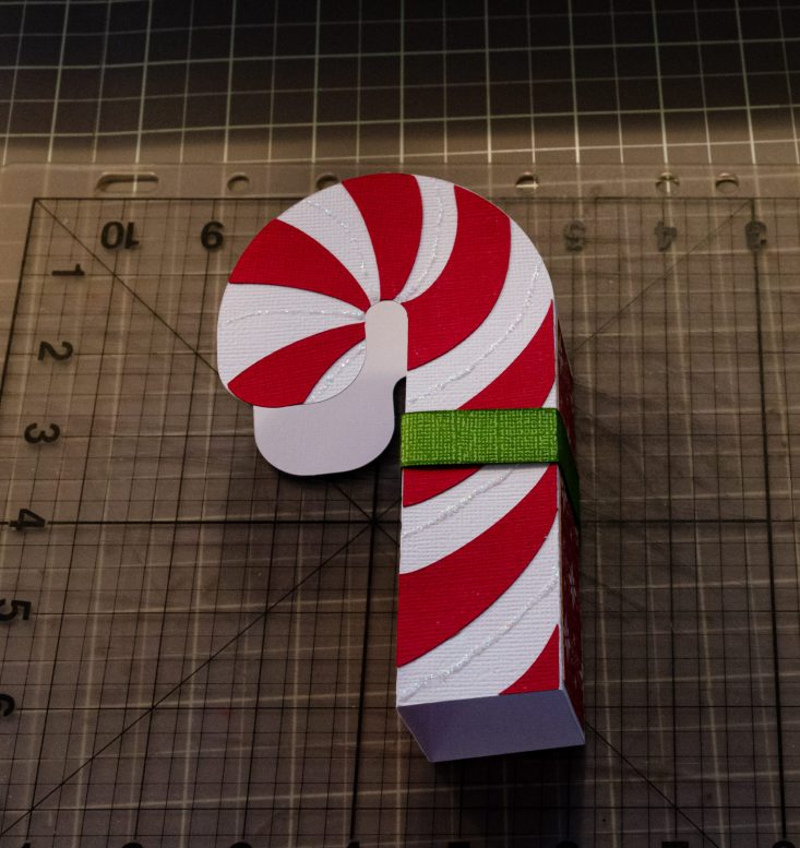 You are looking at the Candy Cane Christmas card folded and glued together. I glued the bow's ribbon base around the card. I will then place the bow on top.