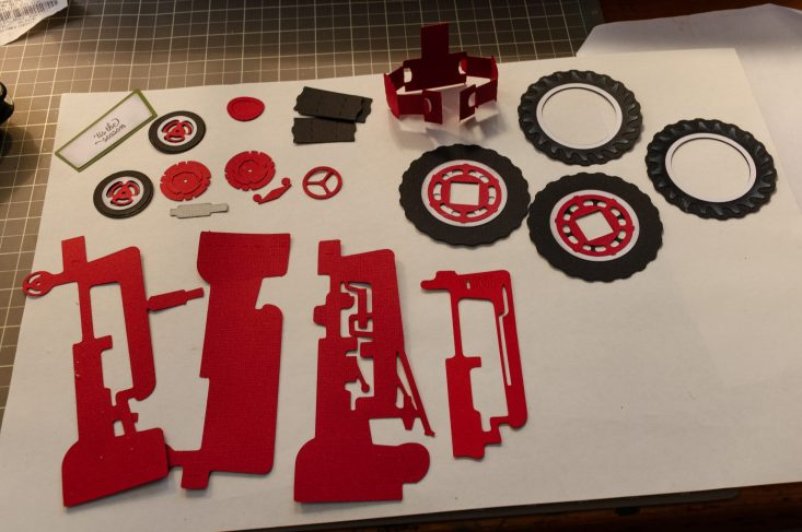 You aree looking at the Christmas Tractor Box Card pieces that I have assembled, glued together. I also inked around the pieces so they would stand out.