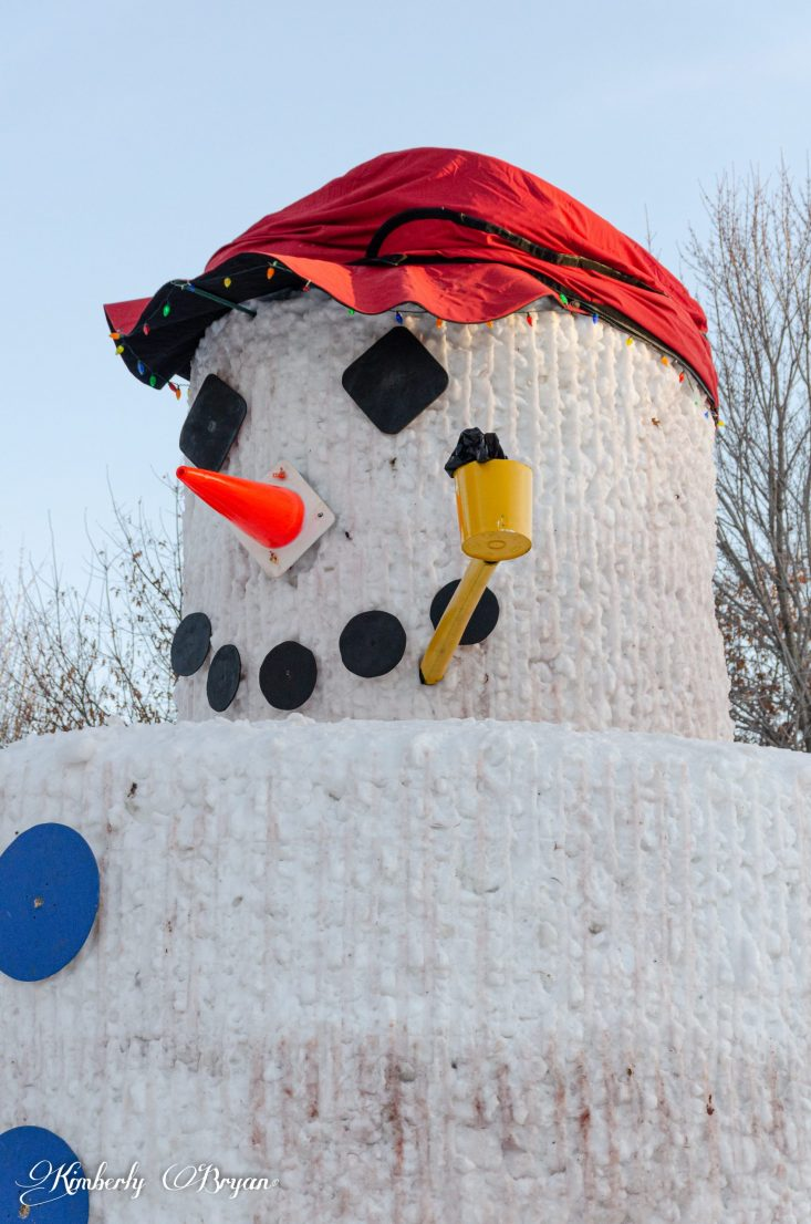You are looking up close at Snowny Kromer the 30 foot tall snowman. There's Christmas lights going around the rim of his hat to brighten up his face. This is from my post, Merry Christmas From Snomy Kromer.