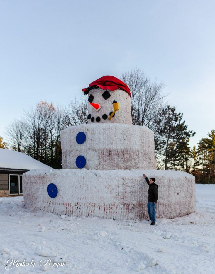 Merry Christmas From Snomy Kromer, the 30 foot snowman with a 24 foot base. My son who is six feet tall is standing next to Snowmy, who's base is eight feet tall.