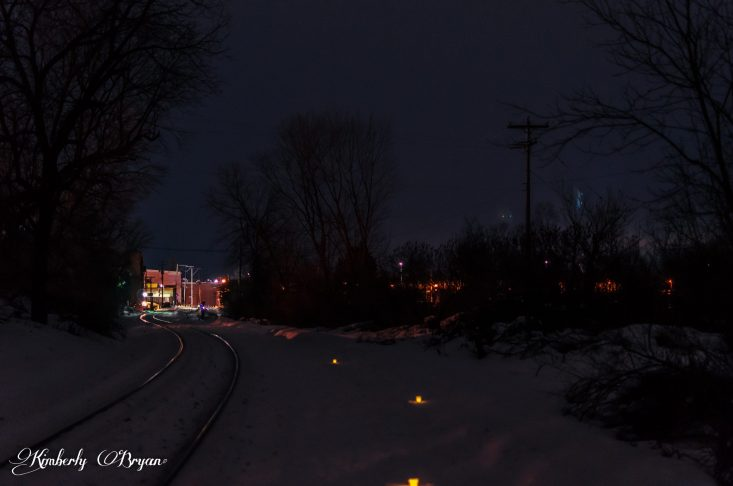 You are looking at the snowshoe trail lit up with candlelight along side old railroad tracks. I could hear a fox yelping off in the distance. This is from my post, Candlelight Snowshoe Hikes.