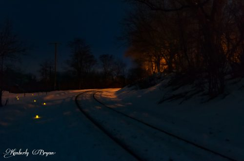 "You are looking at a row of luminary lights along an old train track. THat you can snowshoe or hike along side. This was an event put on by the town of Merrill, Wisconsin. This from my post, ""Candlelight Snowshoe Hikes""."