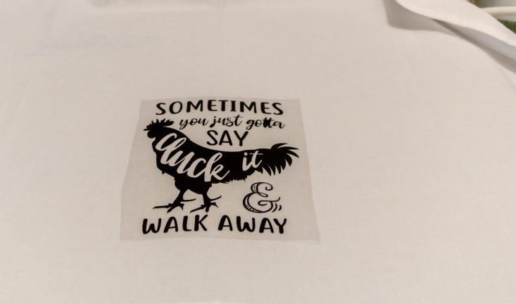 "You are looking at a vinyl design that reads "" Sometimes you just gotta cluck it & walk away"". I have positioned the design in place where I want it. Then it will be heat pressed permanently on the towel."