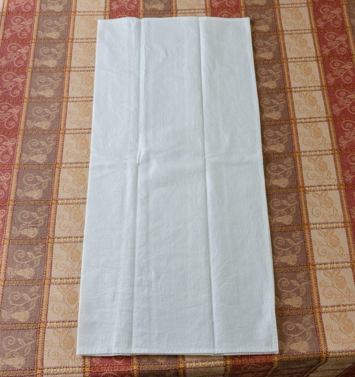 You are looking at a flour sack towel folded in half. I'm showing how I fold mine for the vinyl. This is from my post, DIY Fun Flour Sack Kitchen Towels.