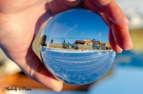 You are looking at a picture of an image through a Lensball. It's a mural of the town of Merrill, Wisconsin.