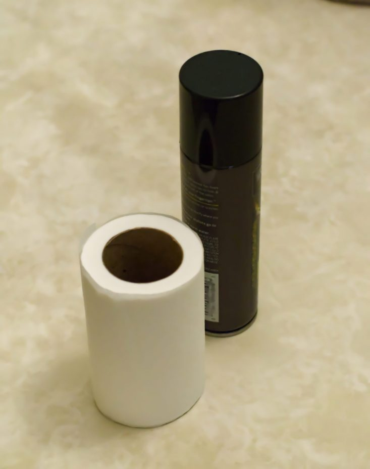 You are looking at a partial used toilet paper and hairspray. I'll spray the hairspray on the edges of the tp so it can't roll. This is from my post, April Fools Joke With A Roll Of Toilet Paper.