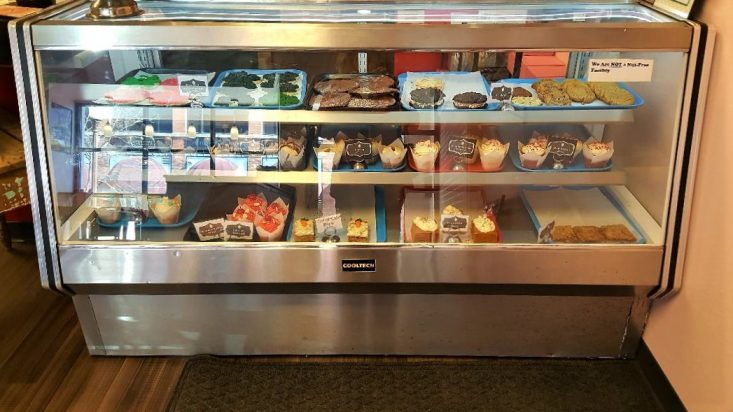 You are looking at a display case filled with cupcakes, cookies and bars in Sweet Lola's. This is from my post, It's My Birthday: Having My Cake.