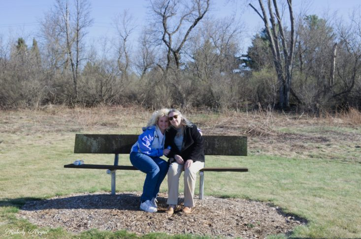 You are looking at a photograph of my mom and I sitting on a bench in a park. giving each other a warm sweet hug. Happy Mother's Day Mom!