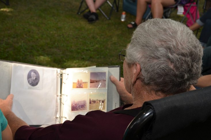 You are looking at a photo of my dad, looking at a photo album of his family. Sharing his family history stories with us. Happy Father's Day to all the dads out there and especially to my dad, Robert!
