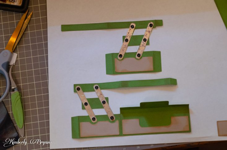 You are looking at the 3d tackle box pieces being glued together. I also glued on tiny black buttons to look like hinges.